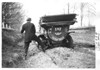 E.M.F. car in ruts on muddy road, on pathfinder tour for 1909 Glidden Tour