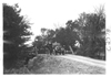 E.M.F. car crossing a small bridge, on pathfinder tour for 1909 Glidden Tour