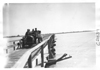 E.M.F. car crossing wooden bridge, on pathfinder tour for 1909 Glidden Tour