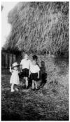 Old straw stack with children