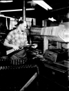 Daisy Manufacturing employee insepcts gun