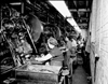 Employees stamping out parts for air rifles at the Daisy Manufacturing Company