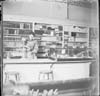 Woman working behind the Counter in a store