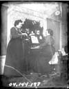 Two Women Playing Musical Instruments