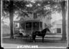 Mrs. Harry Robinson and friend in front of Robinson residence on Penniman Avenue