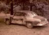 Damaged two door Chevrolet Sedan