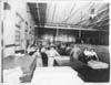 Male and female employees inside Kalamazoo Vegetable Parchment Company