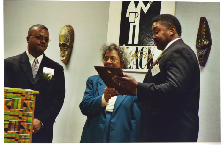 image of Taken at the UAW Local 602 Union Hall during the annual Taste of Black History program (year unknown).  The persons in the photo are, from left to right: Michael Fleming, Mrs. Pressley, Johnny Anthony.