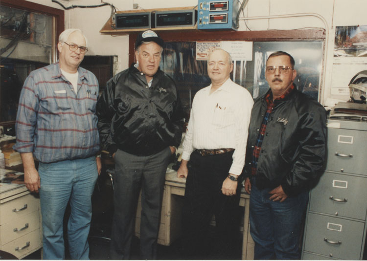 image of Subjects are, from left to right: Unknown, Jim Zubkus (Plant Manager), Unknown, Ed Evert.