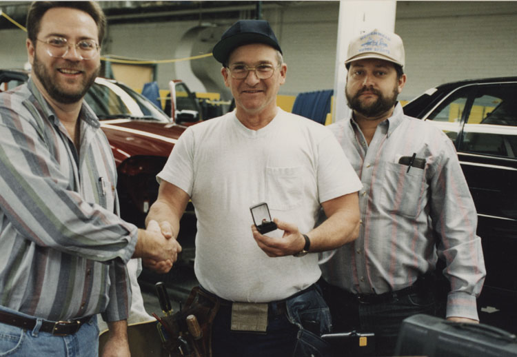 image of Subjects are, from left to right: Garry Bernath (Local 602 President), Al Staley, Rusty Zeigler (UAW Bargaining Committee).  Zeigler and Bernath are presenting Al Staley with a  UAW Local 602 ring . Staley has achieved twenty-five years of service.