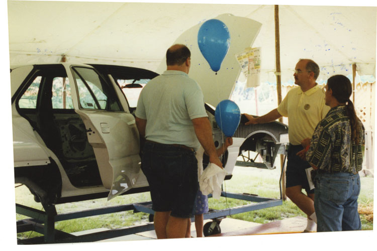 image of Looking over a Pontiac Grand Am body on display at the UAW 602 Annual Family Picnic.