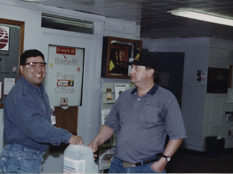 image of Conducting a gate collection for the victims of the Oklahoma City tornado disaster, which destroyed part of the GM assembly facility there on May 8, 2003.  Subjects are, from left to right: Bob Rodriguez, Rusty Zeigler.