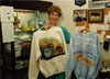 "Judy Devers displays merchandise in ""The Emporium"", a gift shop run by salaried women on a volunteer basis raising funds for charity."