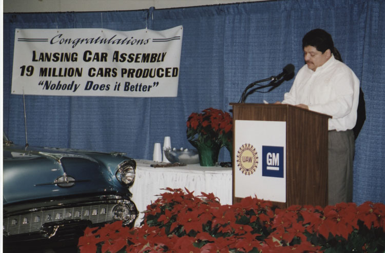 image of A celebration marking the achievement of producing 19 million vehicles at the at the Fisher Body plant in Lansing, MI.  The Fisher name was dropped in 1985 when the corporation was reorganized and the plant became the Lansing Car Assembly Body Plant, Small Car Group, BOC.  Subject is UAW Local 602 President Art Luna.