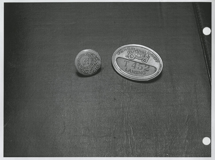 image of Objects are, from left to right: February 1938 Union dues pin given to members as they paid their dues to the union stewards who had to collect the dues monthly from each member in their district.  Fisher Body employee identification badge, era unknown.
