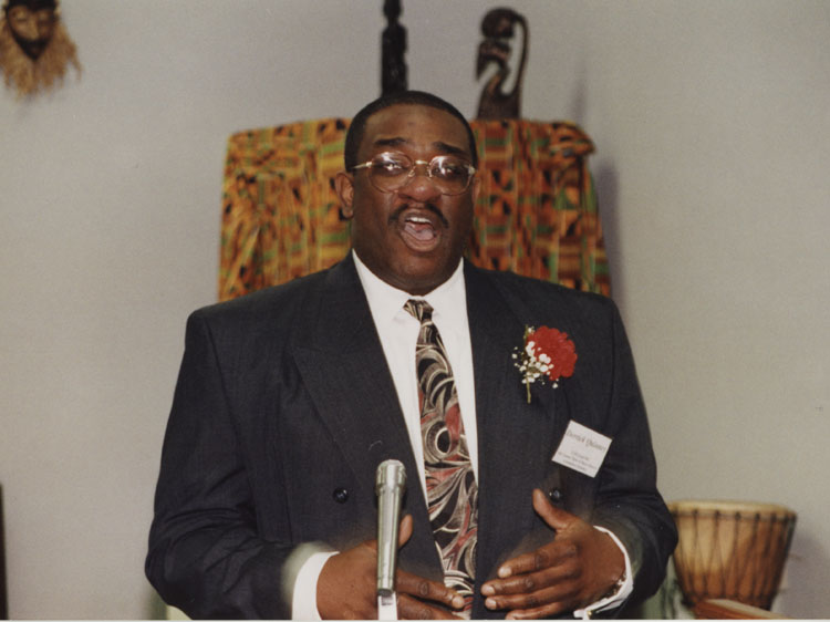 "image of Derrick Quinney receives the Alvin J. Pressley ""Trailblazer Award"" during the 1999 annual Taste of Black History Program."