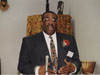 "Derrick Quinney receives the Alvin J. Pressley ""Trailblazer Award"" during the 1999 annual Taste of Black History Program."