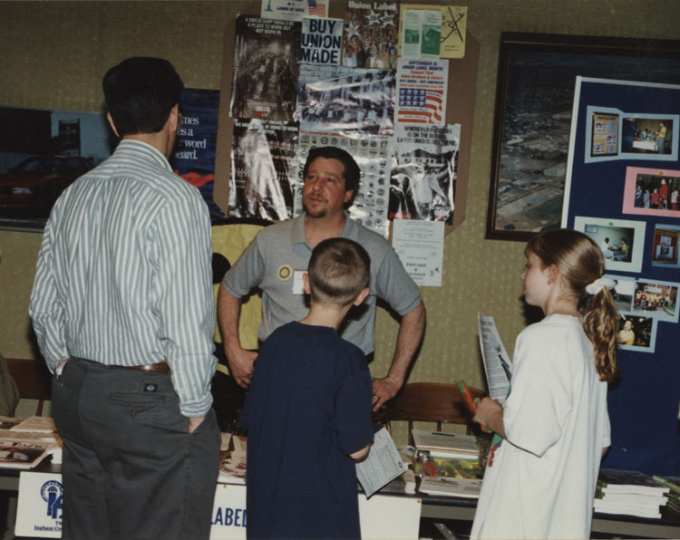 image of Doug Rademacher talks to families touring the plant on Take Your Child to Word Day. Doug is serving as Chair of the Union Label Committee promoting union made products and services.