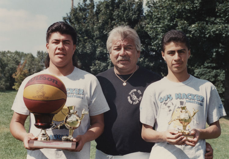 image of Rene, Joe, and Aurelio Rodriguez following the completion of a Gus Macker Three-on-Three Basketball Tournament.