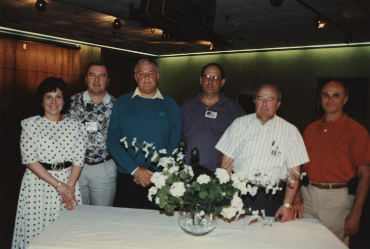 image of Subjects are, from left to right: Barbara Rossi, Jim Gaunt (Personnel Director), James Zubkus (Plant Manager), Glenn Kirk (Comptroller), Bill Bengel (Materials Director), Jim Edwards.  Barb worked directly for Zubkus and supported the others as necessary.