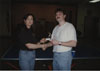 Renida (RT) Taylor giving a trophy to a ping-pong champion following an event conducted by the Recreation Committee.