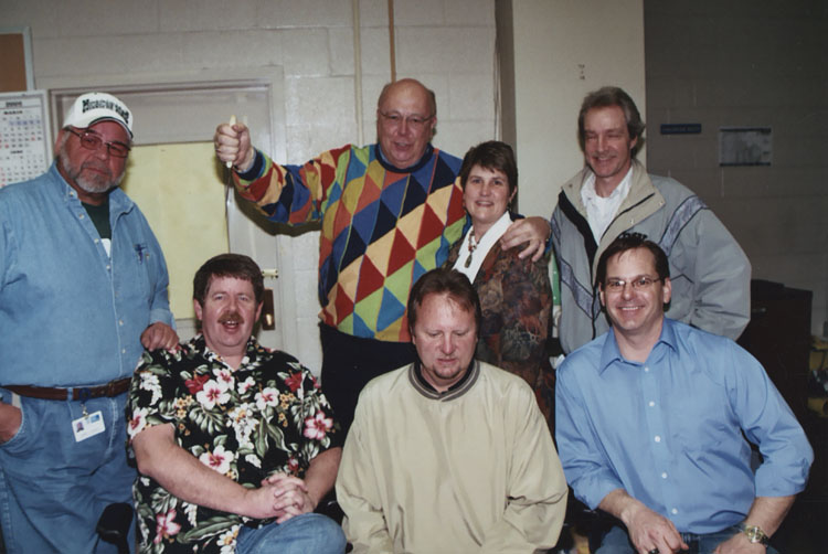 image of Subjects are, from left to right: seated – David Brown, Kevin Mix, Jerry Chaffin; standing – Larry Spiece, John Rosendahl, Barbara Sanders, Mike Bentz