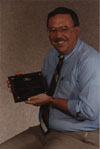 John Rosendahl posing with his plaque, received for his service to the Cystic Fibrous Foundation.