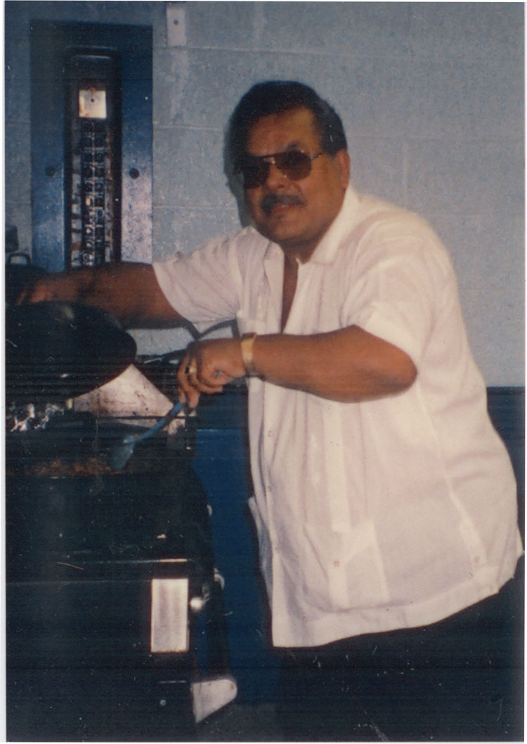 image of Atanacio (Nacho) Trigo Jr. cooking at the 1st Annual Hispanic/Latino Celebration held at the UAW Local 602 Union Hall.