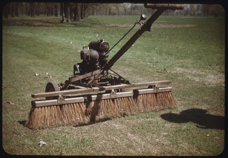Broom on power mower brushes G