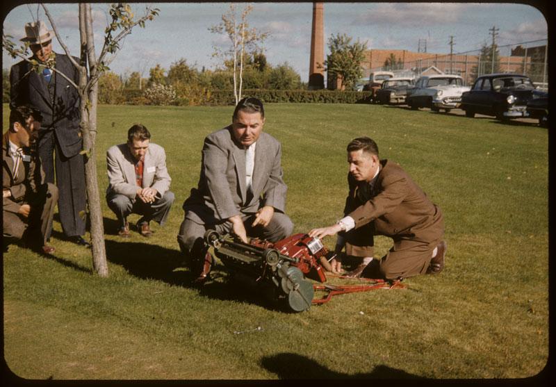 Babe Brinkworth demonstrates mower adjustments