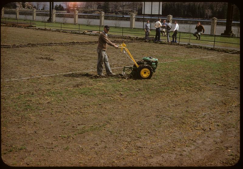 Dowfume Garden tractor plows furrow for tarp
