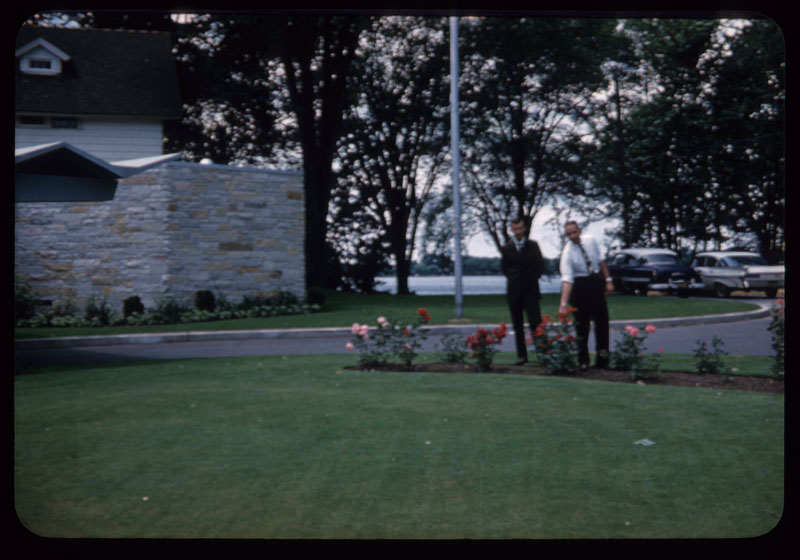 Carl Andre & Roy Peck admire roses